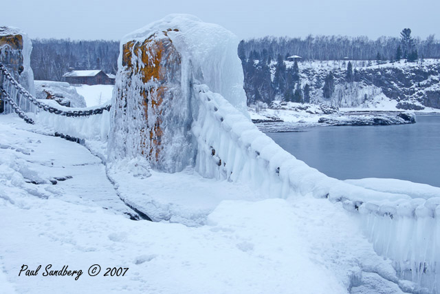 In the winter, I enjoy the high waves as they usually cover the trees with ice along the shore of Lake Superior. On shore winds are necessary for the spray to reach the shoreline. Most of the high winds this winter have been from the Northwest so we haven't seen much spray freezing to the trees and rocks.