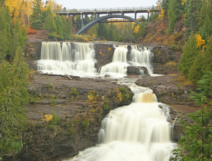 Lower Gooseberry Falls<br /> <br /> Some years the colors are at their peak for only a few days. This fall we had terrific colors for almost four weeks. Every chance I got, I headed for the woods to hike along the North Shore rivers or climb up to an overlook to be inspired by the exceptional beauty of the North Shore in its fall wardrobe.