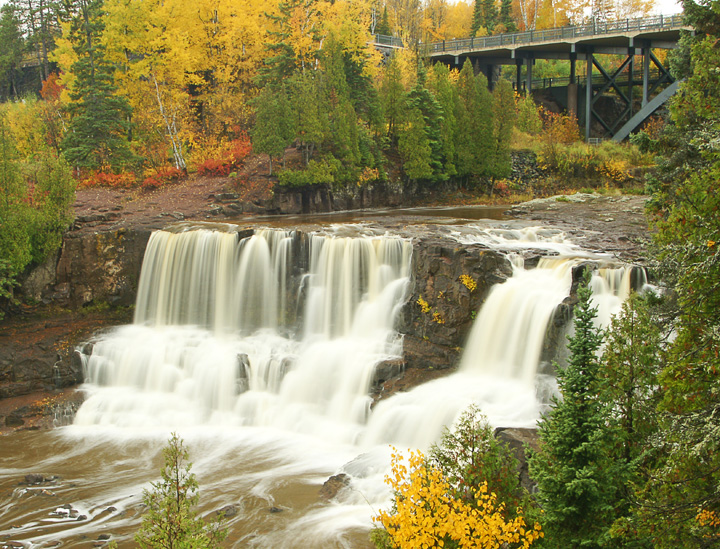 Middle Gooseberry Falls<br /> <br /> Most of the bright red, gold and orange leaves that made this year's fall colors so breathtaking are now on the ground.  The colors lasted much longer than any fall I can remember.