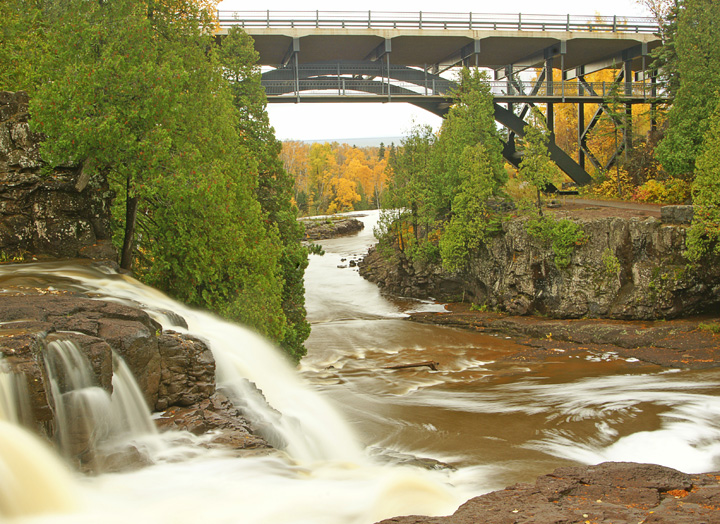 Upper Gooseberry Falls<br /> <br /> I wasn't alone in my quest to see the fall colors. One Saturday, we broke the attendance record at Gooseberry Falls State Park with almost 7,400 visitors enjoying the waterfalls surrounded by magnificent splendor.