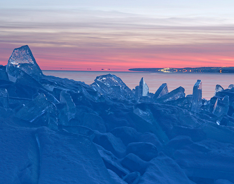 Ice Shards 005<br /> <br /> As the evening got darker the lights of Duluth showed on the horizon. The brightest ones are the lights at Spirit Mountain Ski Area.