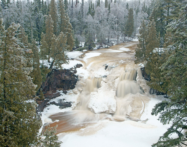 Upper Gooseberry Falls<br /> <br /> The rain that formed the ice on the trees also opened up the rivers.