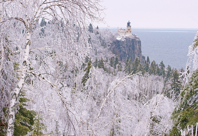 Split Rock Lighthouse After the Storm<br /> <br /> Last week we had one of the worst ice storms that anyone can remember hit the North Shore. It seemed like Tettegouche State Park was in the center of the storm with over one inch of ice covering all the trees and branches. With that much ice most of the trees either lost limbs or the entire tree came down. It is anyone's guess how many trees were lost between Two Harbors and Grand Marais. The ice covered trees were beautiful when seen from the overlooks along Hwy 61.