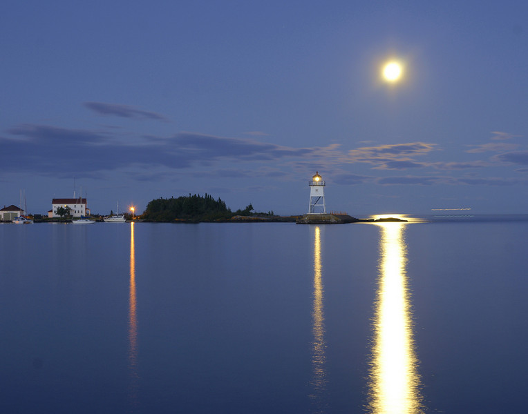 "Moonrise Over Grand Marais<br /> <br /> It couldn't have been a more perfect evening. I think the statement of a young girl as she walked by with her mom said it all, ""I can't believe my eyes. This is so beautiful""."