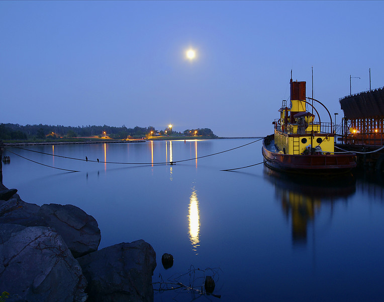 Moonrise Over Agate Bay<br /> <br /> The last five days were an absolutely beautiful week of summer weather. Four days in a row Lake Superior was like glass plus it was also full moon week. I photographed the moon rise over Two Harbors' Agate Bay. With the reflections of the lighthouse and the Edna G it was a magical evening.