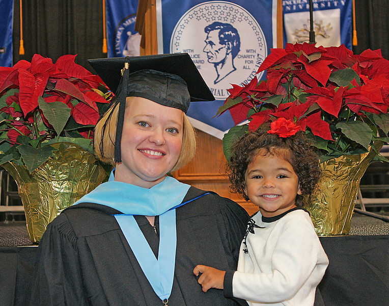 "Graduation<br /> <br /> Rebecca wants her daughter, Addie, to realize the importance of education early in life so she decided to walk for commencement. When Rebecca walked across the stage, Addie stood up on her proud grandma's lap and shouted ""Yeah, Mommy"".  About 100 people turned around and looked at Addie with smiles on their faces."