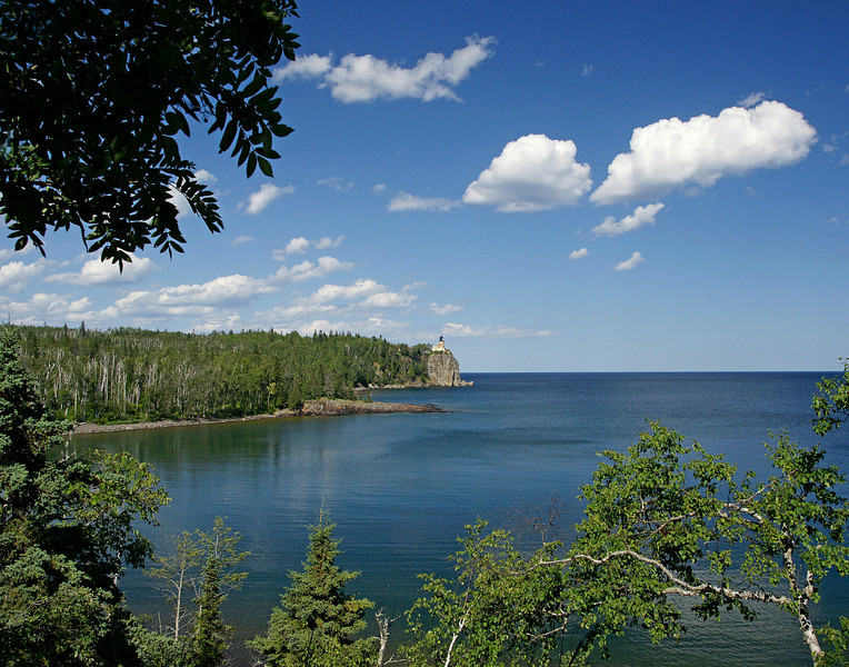 Split Rock Lighthouse State Park 002<br /> <br /> Many activities are scheduled to celebrate this summer but the most relaxing of all is just sitting on the cliffs in front of the cart-in campground and watching the summer clouds pass over the light.