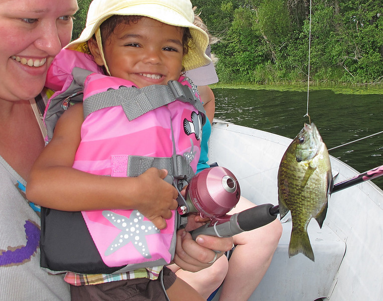 Moose Lake State Park 004<br /> <br /> Our granddaughter had never been fishing before and was quite happy with her first fish. Several of the state parks have kids fishing kits to loan out making it easy for kids who have never fished before to enjoy the experience. Adeline was one of those taking advantage of the program and it certainly put a smile on her face.