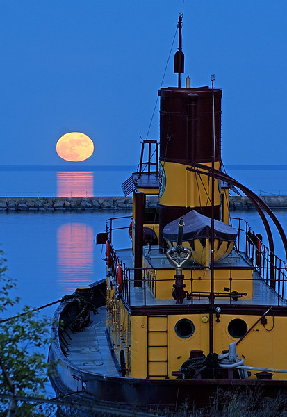 Moonrise Over Agate Bay 001<br /> <br /> Since the 1800's the Edna G has been gracing moonrises over Agate Bay in Two Harbors. The Edna G was the last steam tugboat used on Lake Superior to help ore boats enter and leave the Two Harbors ore docks. She is now permanently moored at the dock and open for tours at various times.