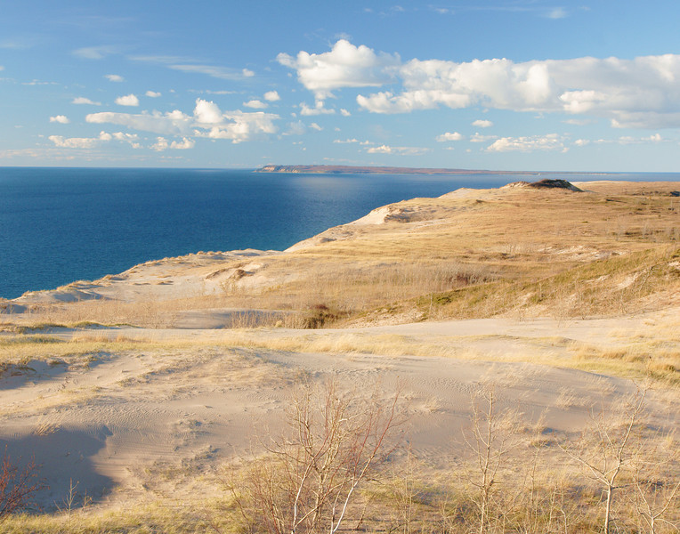 Sleeping Bear Dunes National Lakeshore 002<br /> <br /> In this photo the black vegetation in the distance that appears as a sleeping bear gives the park its name.