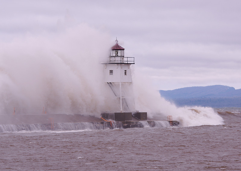 Lake Superior Storm 004<br /> <br /> <br /> Watching the waves collide with the lighthouse was an incredibly loud and powerful experience.  Where people normally walk along the break wall in front of the light was not an option.