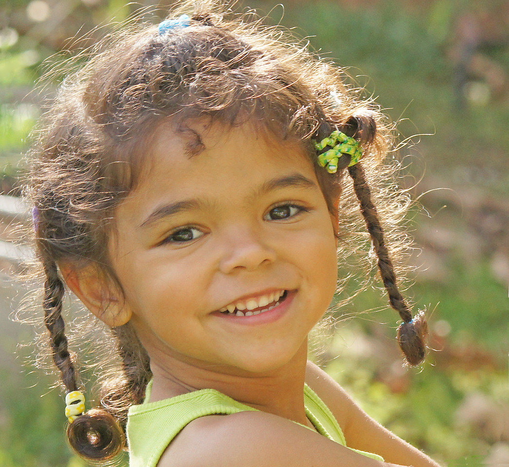 Addie Enjoying the Outdoors<br /> <br /> This is the smile on her face as she pointed to the wild anole that hung out around her playhouse.