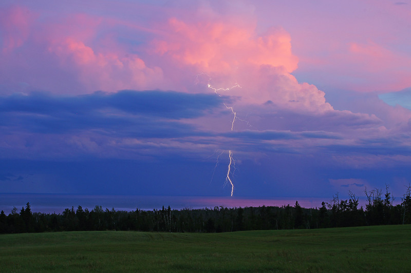 Storm Over Grand Marais 0010<br /> <br /> Of the three dozen or so shots that I took I was fortunate enough to get one photo that captured the lightning bolt hitting the lake.