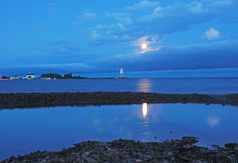 Fisherman's Picnic Full Moon Over The Grand Marais Harbor 001<br /> <br /> Fisherman's Picnic coincided with the full moon this year so many of the campers in the Grand Marais campground gathered along the beach to watch the full moon come up both Thursday and Friday nights.