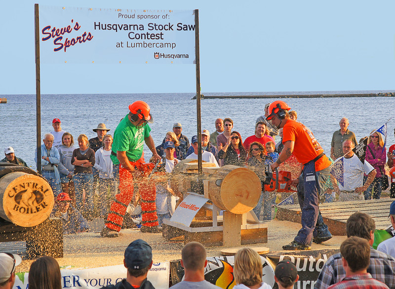 Fisherman's Picnic Stock Saw Contest<br /> <br /> This weekend was the 83rd Annual Fisherman's Picnic in Grand Marais. The weather couldn't have been better. On shore winds kept the temperature cooler and there were several days of beautiful blue sky.  The stock chainsaw contest held at the Lumber Camp Saturday night was well attended. We knew some of the participants so it was fun to watch.