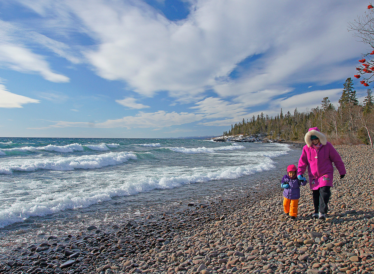 Walking the Beach<br /> <br /> After sliding on the hill in Grand Marais we spent some time on the beach. The waves were crashing onto the shore which was pretty exciting for a little girl from Atlanta.