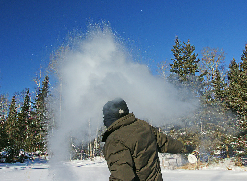 Vaporized Hot Water<br /> <br /> Winter finally arrived in Minnesota.  We have experienced below zero temperatures for most of the week. On Thursday morning our thermometer read -20.  At -20 degrees hot water will vaporize in less than a second.  As soon as I threw this cup of boiling water into the air a gust of wind came up.  It sent the water back into my face and made me cringe but the water was already vaporized and cool.