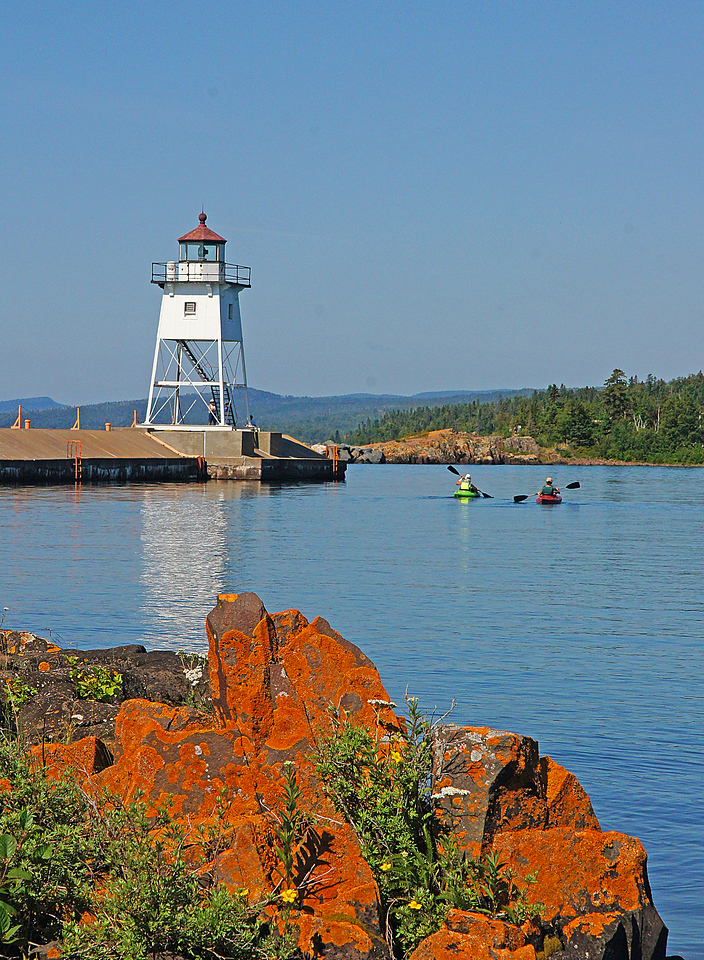 Grand Marais Harbor 002<br /> <br /> Kayakers paddled the calm waters of the harbor, while others just walked along the beach taking in the sights and sounds of Lake Superior.