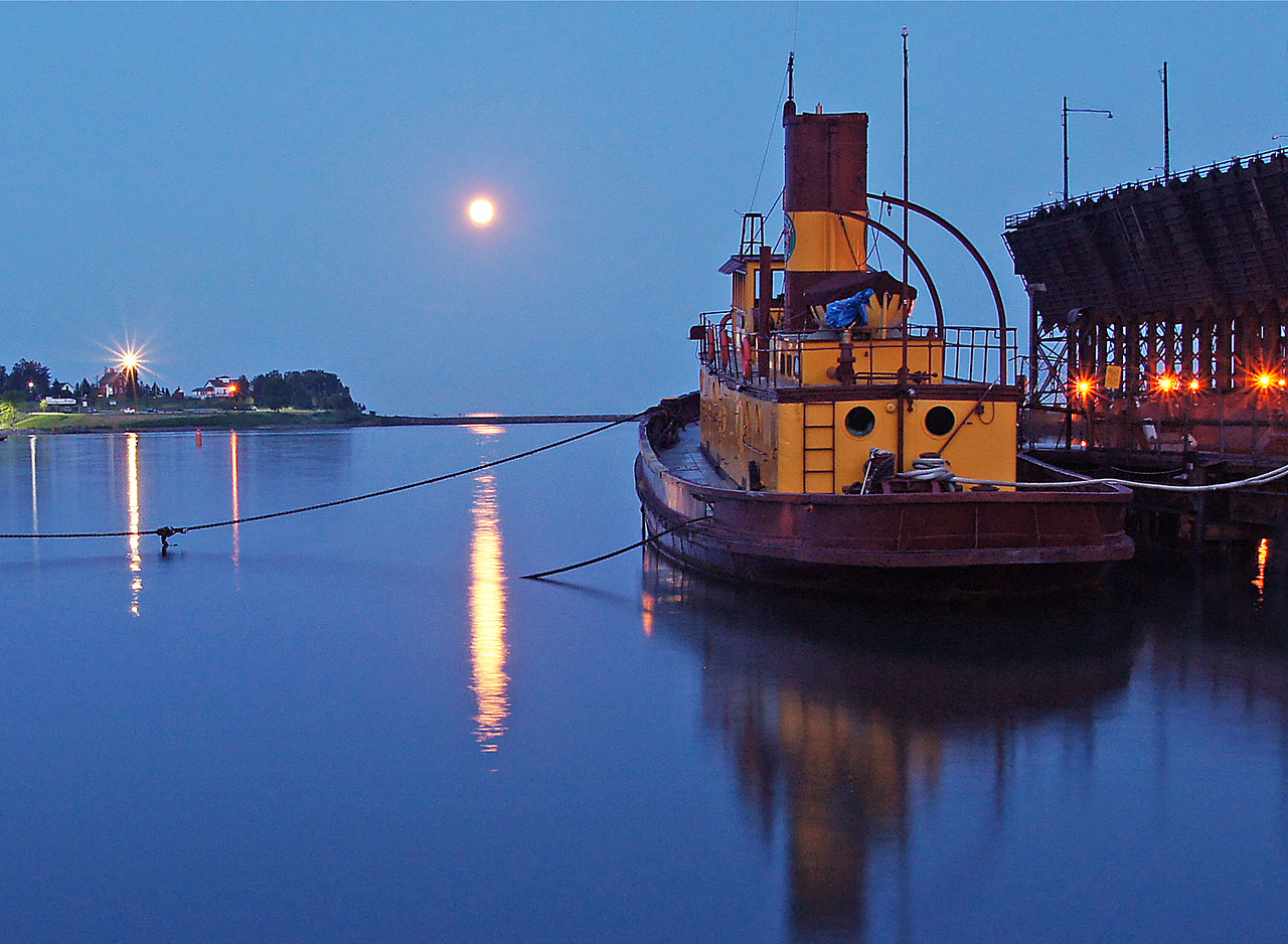 Egna G. Moonrise<br /> <br /> The last evening we camped was the night of the full moon. It was fun to watch it come up behind the Two Harbors Light Station and in front of the Edna G.