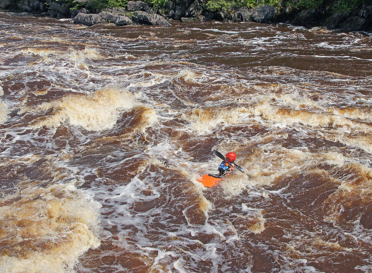 Jay Cooke State Park 004<br /> <br /> As they came under the swinging bridge they had a very short margin of error to get themselves across the current and into the eddy where they could take their kayaks out of the river.