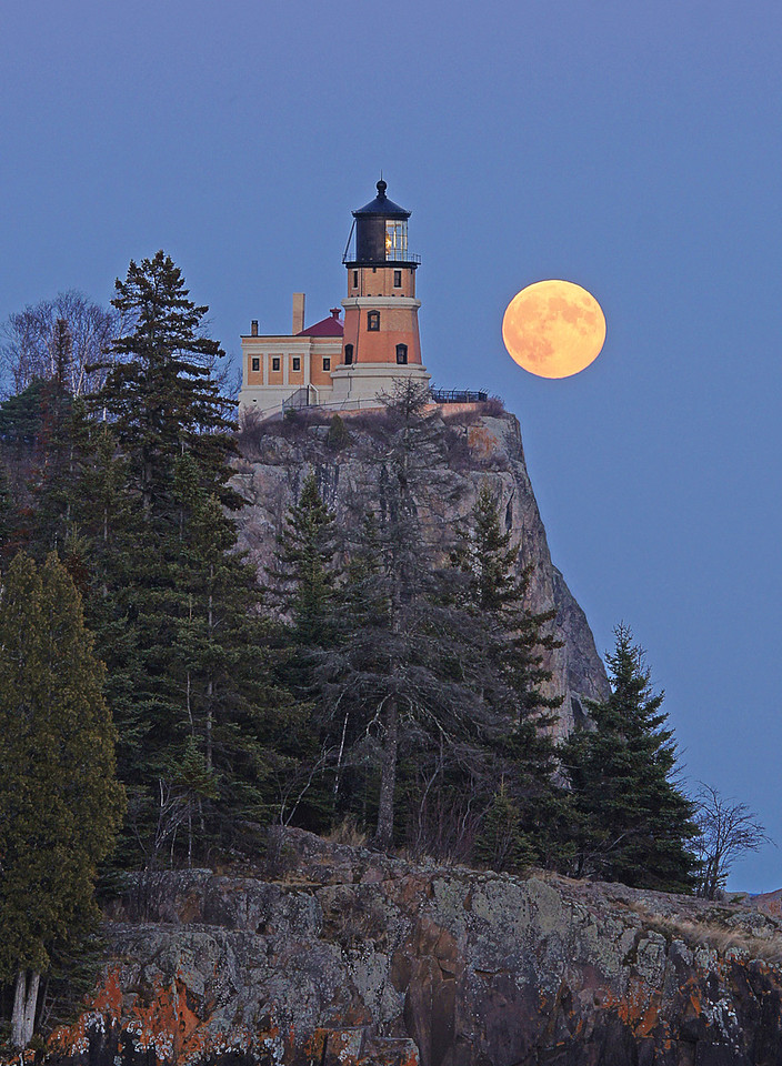 "Hunters Moon Over Split Rock 001<br /> <br /> Beginning in late October and continuing through the month of February the path of the rising full moon crosses behind the historic Split Rock Lighthouse.  October's full moon is called the ""Hunters Moon"" and on Monday we drove down the shore with hopes that the skies would be clear so we could photograph this magical event. Watching the moon rise behind the lighthouse is never a disappointment but this one was breathtaking."
