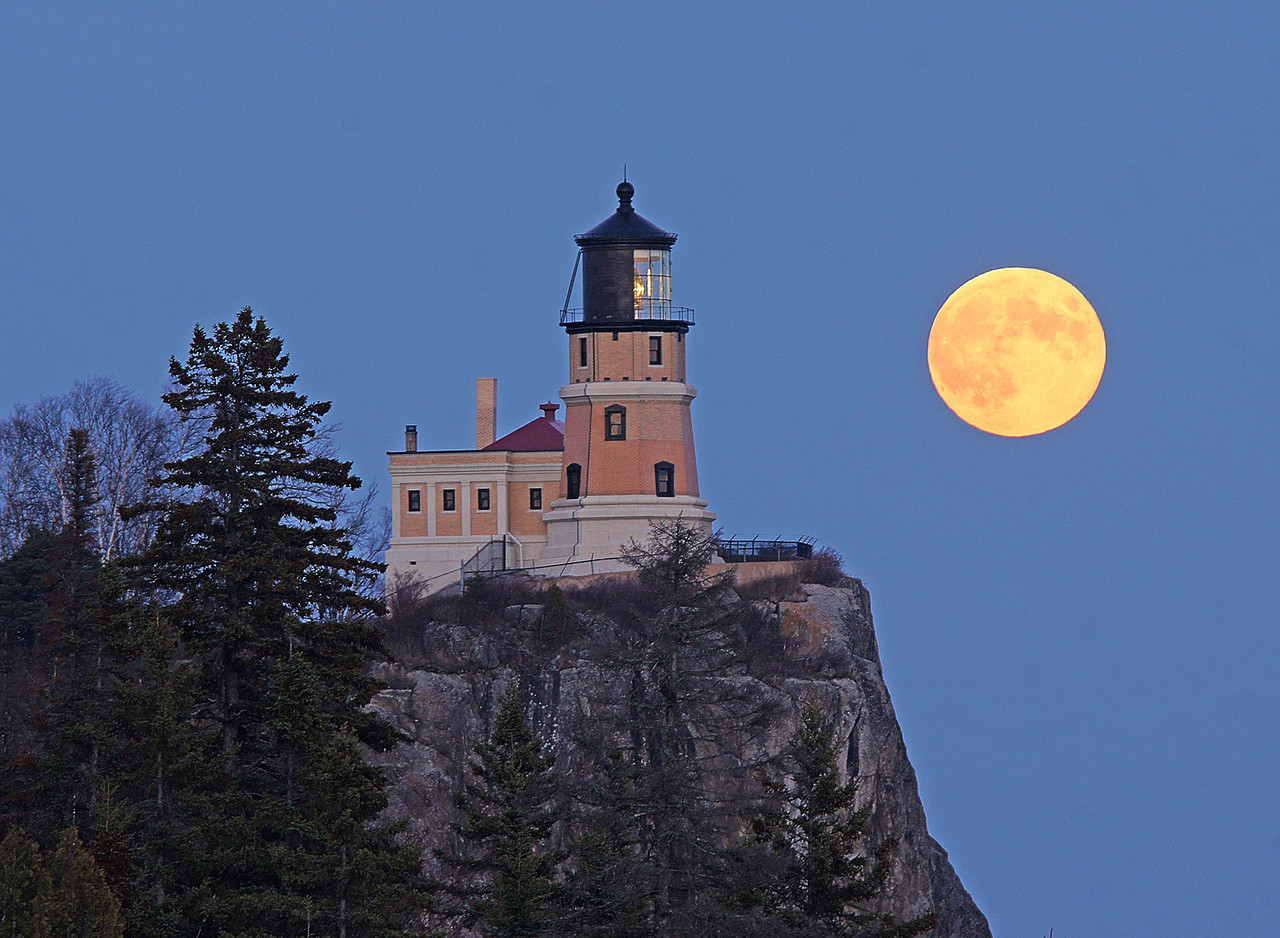 Hunters Moon Over Split Rock 002<br /> <br /> The sun set just minutes before the moon came around the cliff making it exceptionally bright.  The orange glow from the moon was so captivating that it just held your attention. There were only four other photographers sharing in the moment.