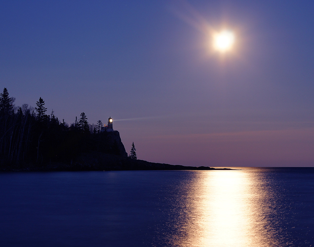 "Hunters Moon Over Split Rock 004<br /> <br /> My last photo was a 30 second exposure capturing the beam of light as it penetrated a light fog coming off of Lake Superior. <br />   <br /> The next time the light will be turned on will be this weekend on November 10 for the annual beacon lighting to commemorate the loss of the freighter ""Edmund Fitzgerald"" which sank in 1975. I would highly recommend taking it in."