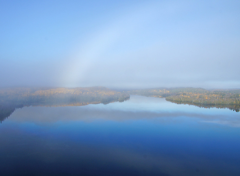 Hungry Jack Lake Fog Bow<br /> <br /> After hiking the trail to Honeymoon Bluff we took pictures of the fog as it lifted off of Hungry Jack Lake. All of a sudden there was a completely white rainbow or actually a fog bow right before our eyes. Neither of us had ever experienced such a sight before.