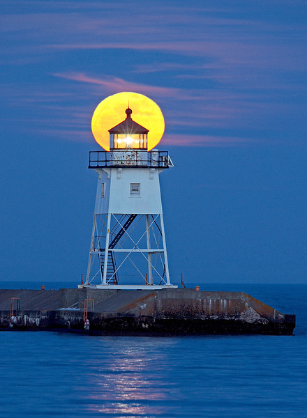 Full Moon Grand Marais Light Station 005<br /> <br /> As the moon rose higher it turned bright yellow and aligned with the Grand Marais light.