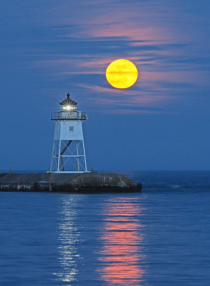 Full Moon Grand Marais Light Station 006<br /> <br /> Soon the clouds that we thought were going to block the moons light earlier turned pink adding a magical charm to the evening.