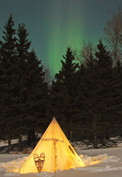 Aurora Borealis<br /> <br /> We had borrowed this canvas tent from friends of ours and were going to head into the BWCAW for a winter camping trip. I put the tent up on our pond behind the house to try it out and that night we had beautiful Northern Lights.