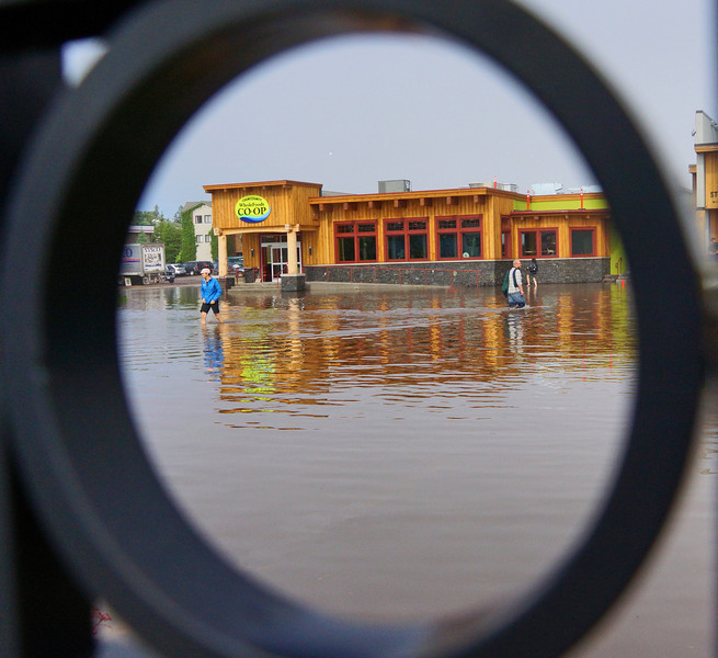 Flooding Grand Marais<br /> <br /> Last week we received a lot of rain. One day over 6 inches fell putting some areas at flood stage including downtown Grand Marais. Shoppers heading to the new Coop store had to walk in water up to their knees.