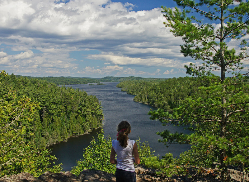 "Caribou Rock Overlook<br /> <br /> After kayaking we hiked to an overlook on the edge of the BWCAW. The view from the top of Caribou Rock overlooking West Bearskin Lake is spectacular and the girls agreed. The two oldest ones told us that it was the best day of their vacation. Of course starting the day with a ""World's Best"" donut and ending with a pretty awesome peanut butter malt might have also played a part in it."