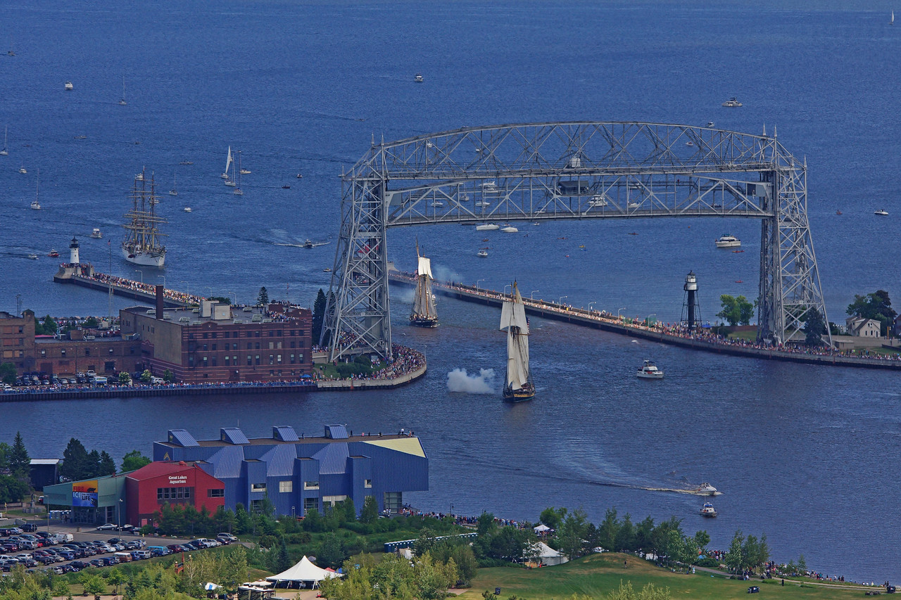 Tall Ships entering Duluth harbor<br /> <br /> We watched the tall ships as they arrived in Duluth on Thursday. The smoke is from the blast of the cannons.