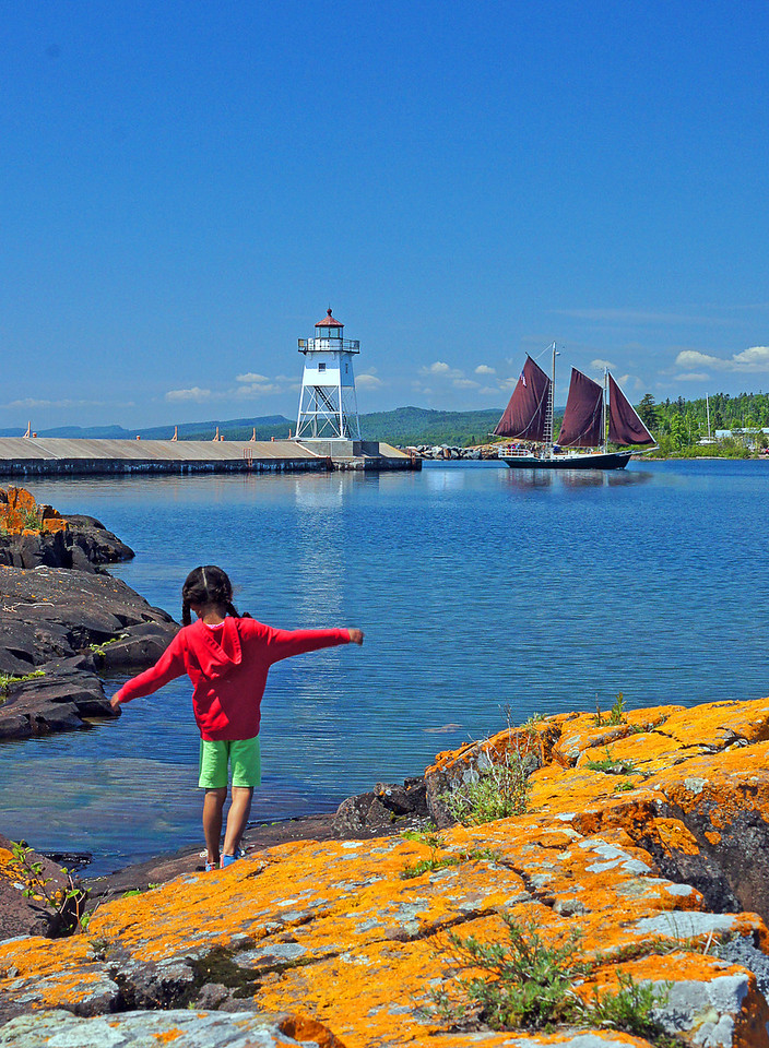 Grand Marais Harbor<br /> <br /> The weather couldn't have been better for the 4th. I asked our granddaughter what she wanted to do for the fourth of July and she said if she could play on the rocks at Artist Point in Grand Marais for 6 hours and then watch the fireworks that would be a good day. So that is what we did.