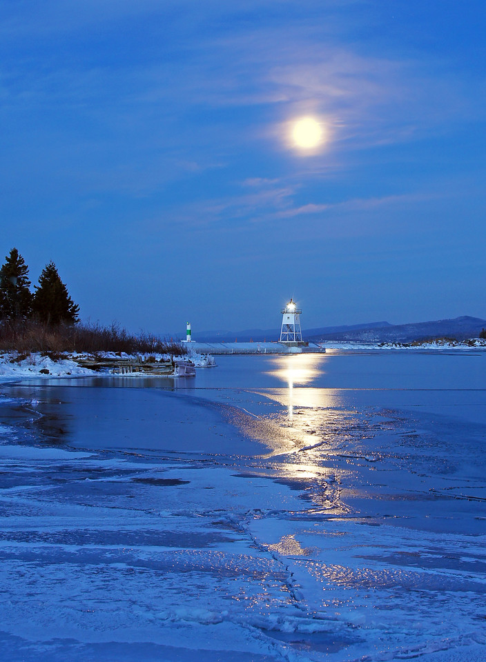 Feb Full Moon Setting on Grand Marais Harbor 001