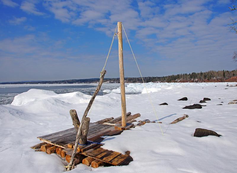 Skiing Stoney Point 004<br /> <br /> I skied past this homemade raft that had washed up on the beach. I would love to know the story behind the making of this not-so-seaworthy craft. It looked like something out of a Huck Finn novel. There are no houses along this stretch of beach so this raft must have floated in from somewhere across Lake Superior.