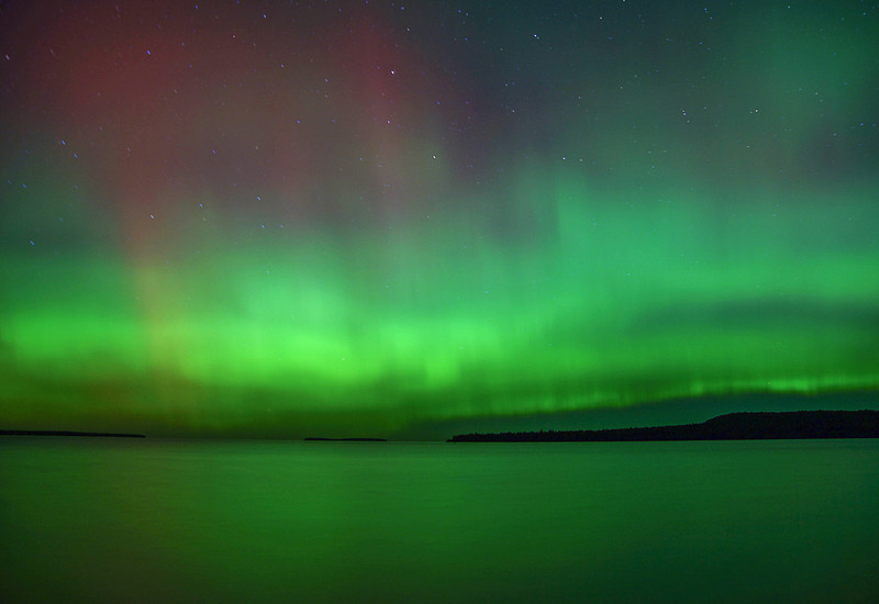 Aurora Borealis 002<br /> <br /> As I photographed the arch it exploded into reds and greens that covered the entire northern sky. It appeared as though the heavens just opened up. What a sight to see over the waters of Lake Superior.