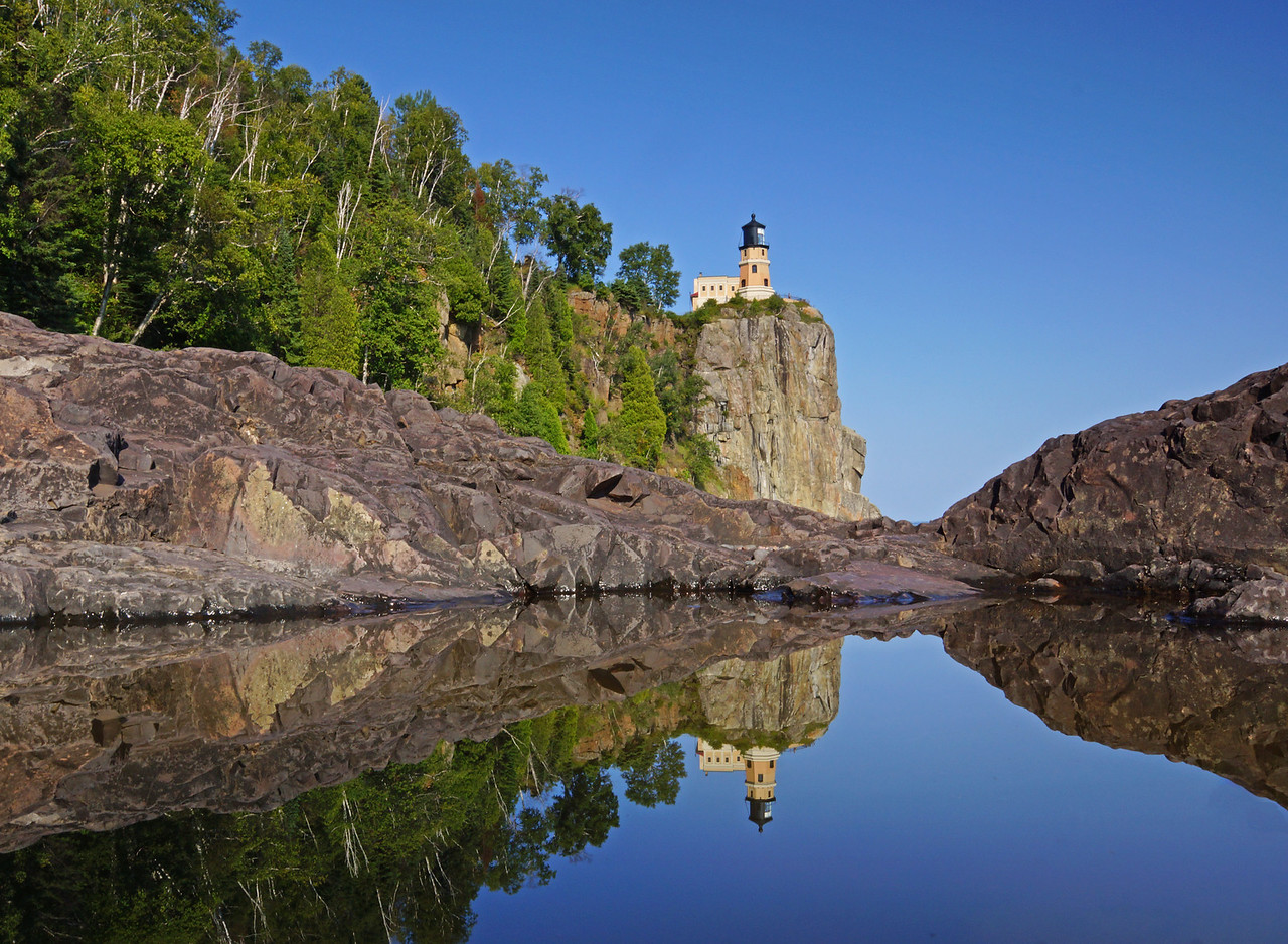 Split Rock Reflections 001<br /> <br /> While passing Split Rock Lighthouse State Park I remembered that I wanted to get some photos of the pools below the lighthouse. It rained this week filling the small pools below the light with fresh water. Since the winds were calm I knew that if I put the camera right on the rocks along side the pools that the lighthouse would be reflected making an awesome photo.
