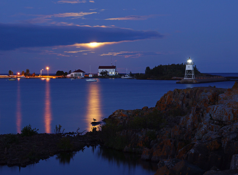 September Moonrise over Grand Marais<br /> <br /> Back in Grand Marais the full moon was lighting up the harbor. This photo was taken on Friday night. Notice the canada goose on the rock in the moon beam. This was  a ten second exposure and the goose was very cooperative standing perfectly still for all that time. In the next exposure the goose was gone. I never saw the goose until I looked at the photos on the camera.