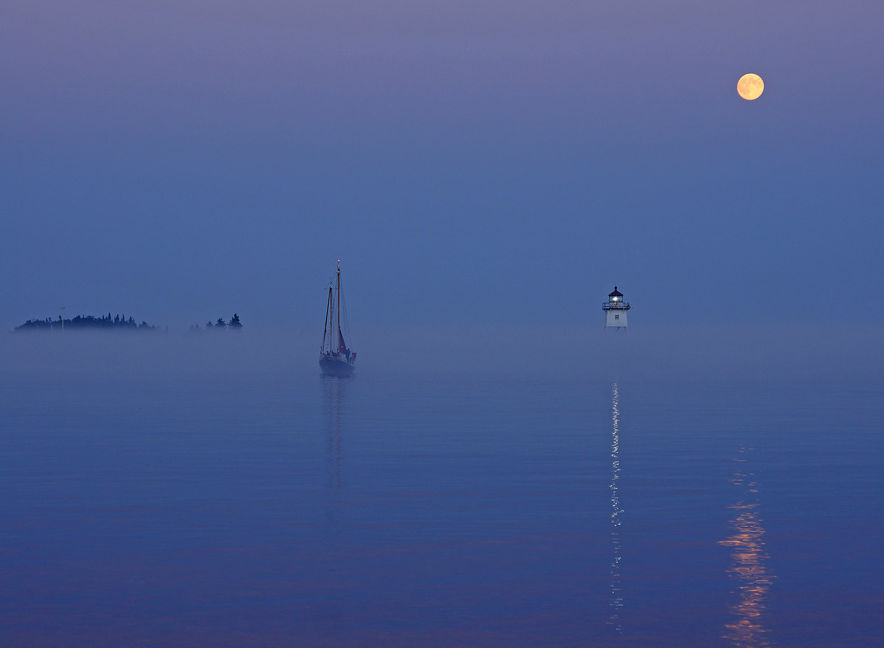 Full Moon over Grand Marais Harbor 001<br /> <br /> This was the night before the full moon last month. The fog rolled in just as the Hjordis was coming into the harbor after it's moon light sail.