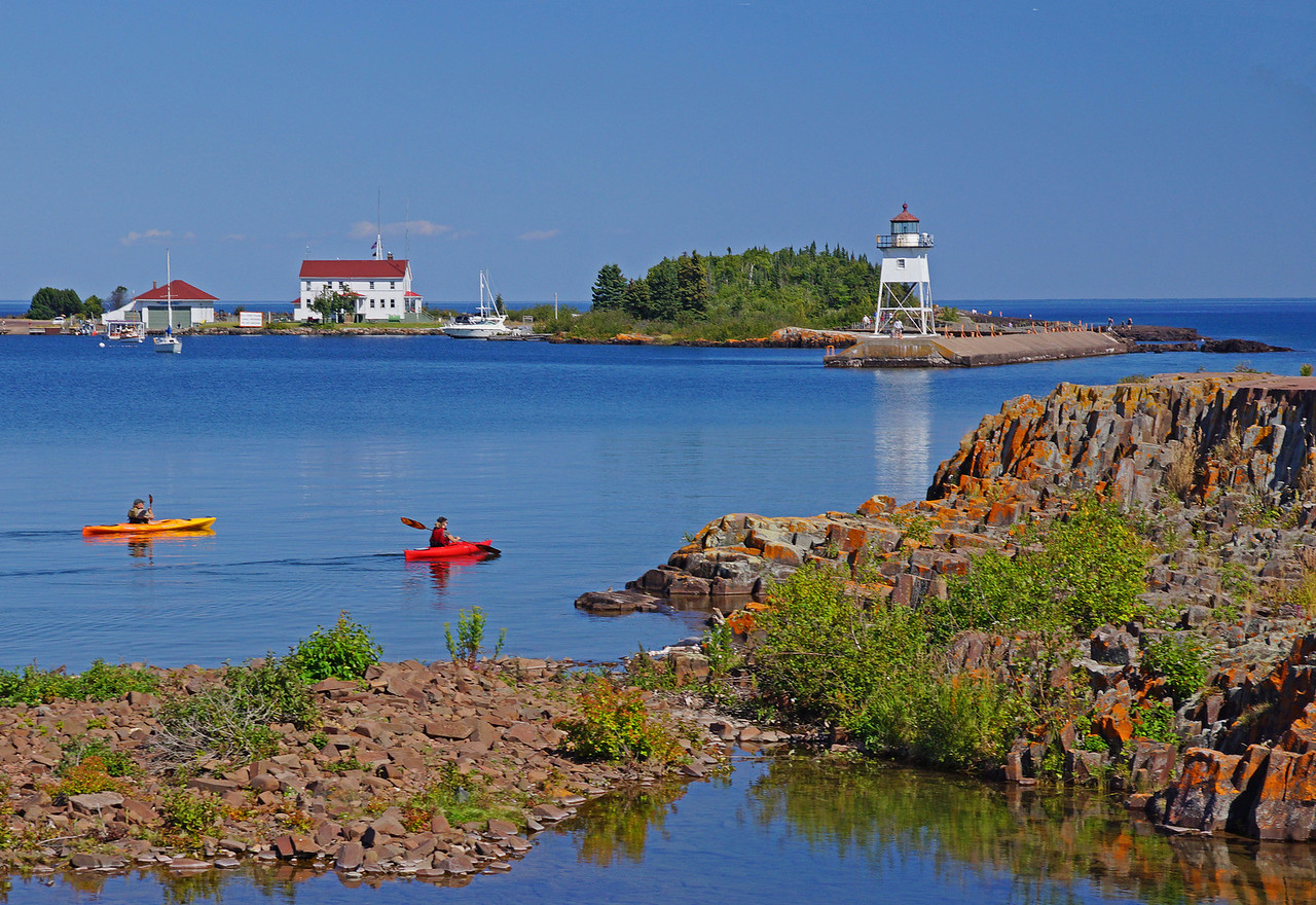 Kayaking Grand Marais Harbor<br /> <br /> I was having lunch along the shoreline in Grand Marais one beautiful afternoon when these kayakers came by.