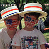 <b>Yankee Doodle Boys—July 2001</b>  In honor of Kate's Month at the Museum, and in memory of my dad, whose birthday would have been Election Day, here's an oldie/goodie (film!). My dad was part of the volunteer team that restored MSI's Milburn electric automobile, which they drove in Hyde Park's Independence Day parade. This shot of my boys (at ages 8 and 5) at the post-parade BBQ is a family favorite. You might notice that Adam is wearing almost as much face paint on his shirt as on his face. That day, I also shot photos of (now-)President Obama dressed as a colonial (and pushing a stroller), Alderman and (now-)Cook County Board President-elect Toni Preckwinkle dressed as the Statue of Liberty, and Illinois Representative Barbara Flynn Currie dressed as Uncle Sam!