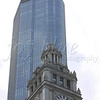 <b>Old and New—11 April 2010</b>  On the way home from my dad's stone setting (on a cold, grey Chicago April day), we made a stop downtown so Number One Son could do a voiceover assignment in the Wrigley building. Here, the Wrigley clock tower appears with the Trump Tower in the background.