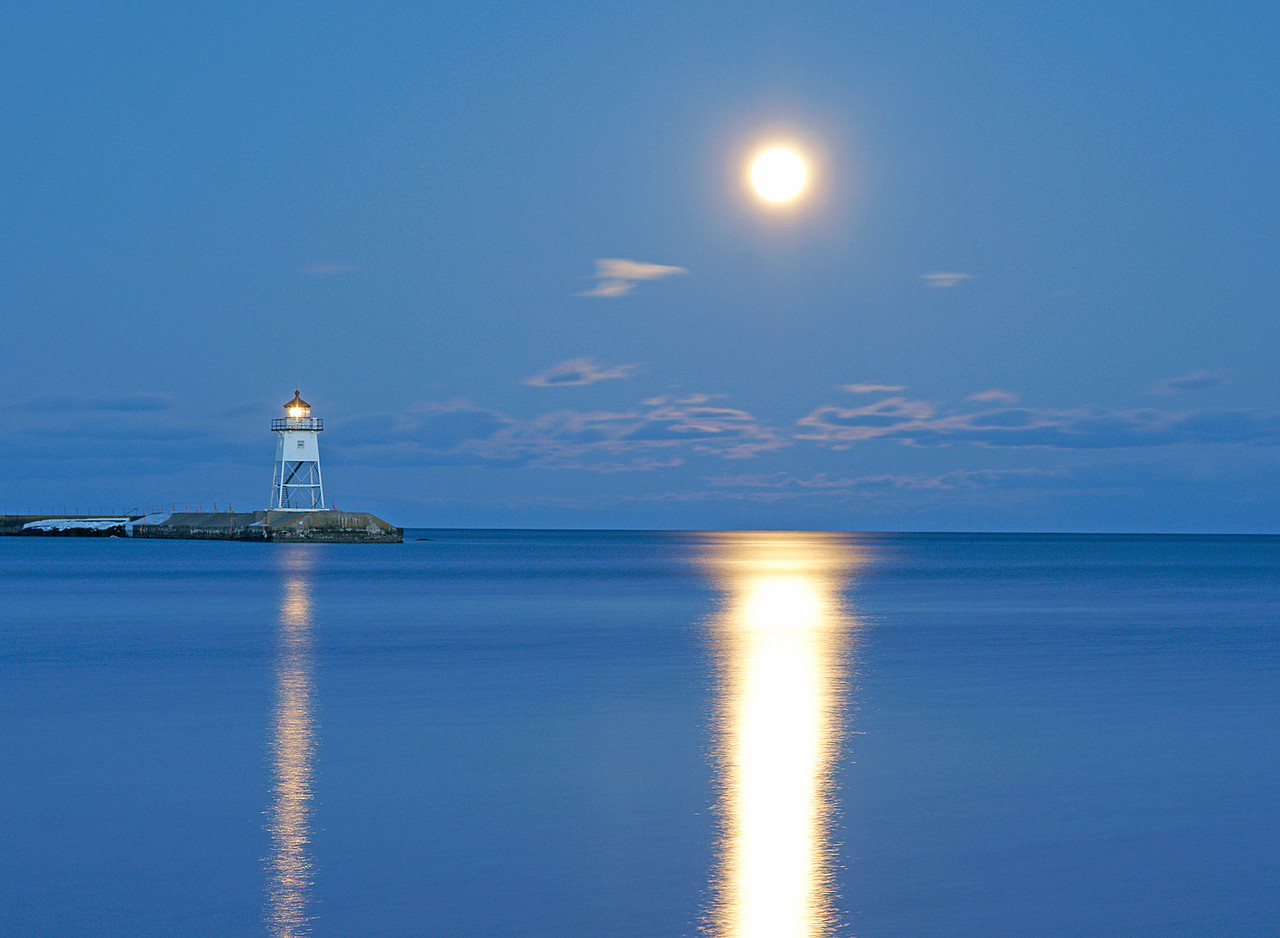 Moonrise on Grand Marais Harbor 001<br /> <br /> Each month I mark the calendar and look forward to the rising of the full moon.  When the moonlight is reflected in water it is much more enchanting.  Along Minnesota's North Coast you can always capture photos of the full moon rising over Lake Superior no matter which month it is.