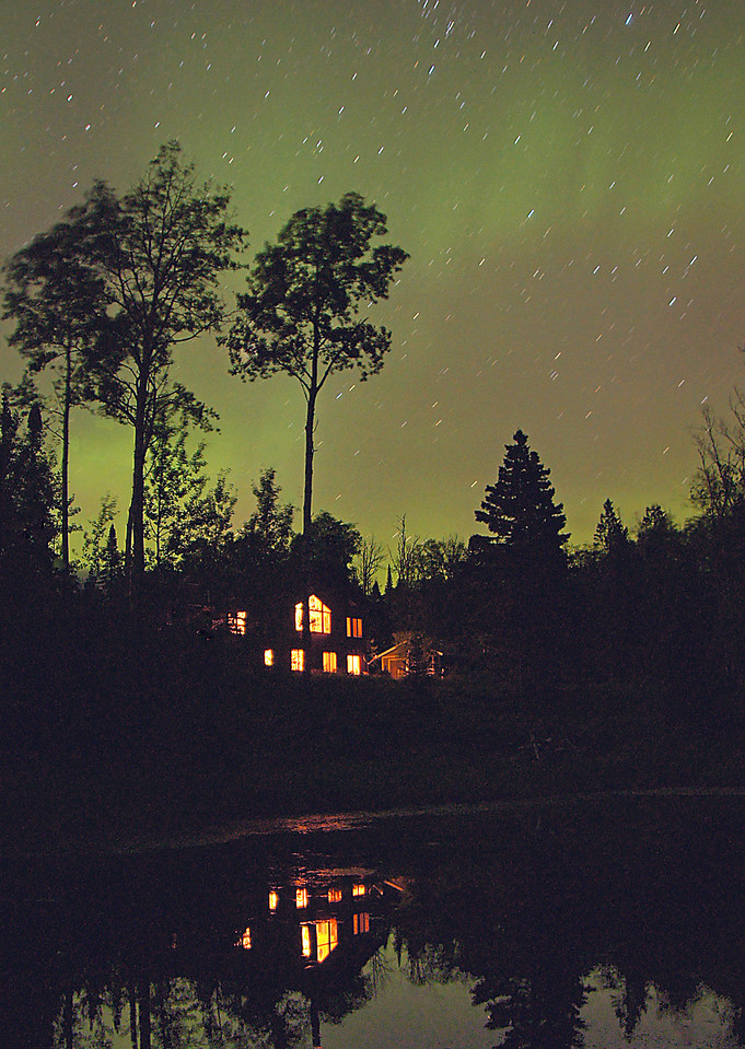 Northern Lights<br /> <br /> After we returned home we heard that there was going to be northern lights that evening. I got up at 1:00 a.m. and looked out the window. The sky was shimmering with waves of green passing overhead. I set the tripod up in front of our lower pond and photographed our house reflected in the pond with the northern lights above.  It was a great way to end a wonderful week on the North Shore.