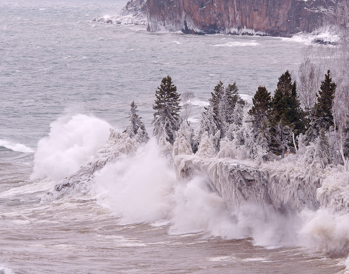 Lake Superior Storm<br /> <br /> On President's Day, 60 to 70 mile an hour winds created huge waves along the North Shore in the area of Tettegouche State Park.  Wave after wave crashed into the cliffs sending the spray into the adjacent forest.