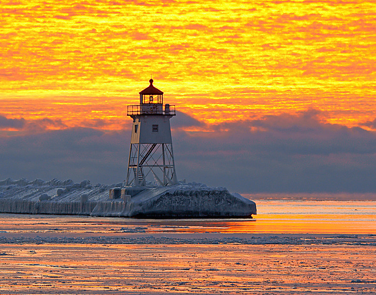 The week ended with a beautiful sunrise caused by rising sea smoke and below zero temperatures over Lake Superior.