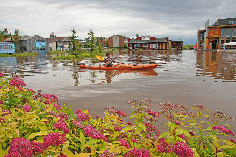 Kayaking Downtown Grand Marais 001<br /> <br /> The intense heat produced a few thunder storms in the area. Almost 4 inches of rain fell in the Grand Marais area flooding a parking lot and a couple of downtown streets. People were kayaking right down the street. Two downtown businesses had water up to their doors.