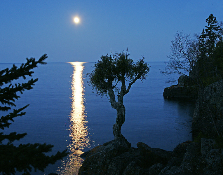 May Full Moon Over Little Spirit Cedar Tree 002<br /> <br /> The tree is held sacred by the Ojibwe, who traditionally leave offerings of tobacco to ensure a safe journey on Lake Superior.  Due to past vandalism problems, a local Ojibwe band member must accompany anyone that visits the site.  I thank Travis for the opportunity to see a spectacular moonrise from such a beautiful location.